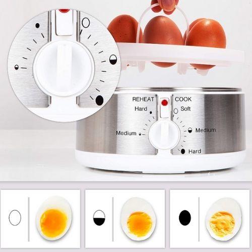 Photo de la machine pour cuire oeufs qui montre les différentes fonctionnalités du thermostat de cuisson avec les résultats obtenir de la cuisson des oeufs durs.